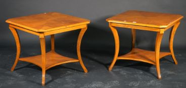 A pair of modern lamp tables, each on swept legs with an undertier, 65cm wide.