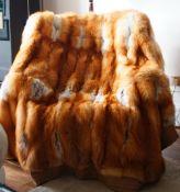 A light brown, tan and white fur throw, 195cm x 206cm.