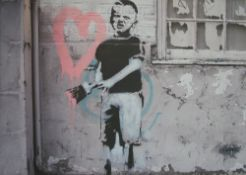 After Banksy, boy with paintbrush, a photoprint on canvas, 83cm x 117cm.