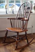 A modern ash and elm spindle back rocking chair, 64cm wide x 115cm high.