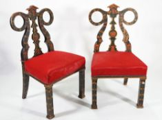 A pair of modern Continental painted hall chairs, on square block supports, 51cm wide x 99cm high,