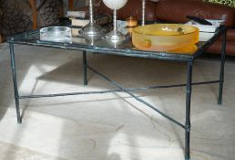 A bronze faux bamboo metal low table with mirrored top, 90cm wide x 45cm high.
