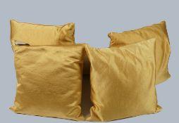 Four silk cushions in gold/ mustard, (4).