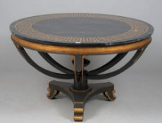 A modern Italian style black painted metal and parcel gilt faux marble topped centre table,