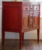 A Louis XVI style red lacquer commode, with an arrangement of various drawers,