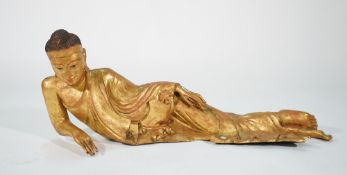 A modern bronze figure of a reclining Buddha, 113cm wide x 49cm high.