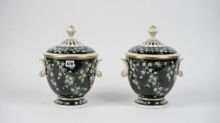 A pair of modern Dresden porcelain vases and covers,