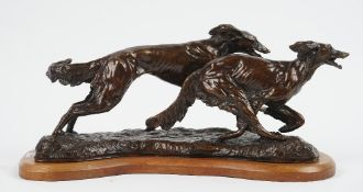 A modern patinated bronze group 'The Chase', depicting two running hounds on an oak plinth,