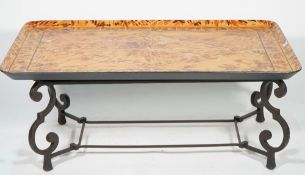 A modern faux tortoiseshell painted tray top coffee table, on metal base, 114cm wide x 45cm high.