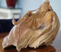A Japanese rootwood carving of a recumbent man, 60cm long, 40cm high.