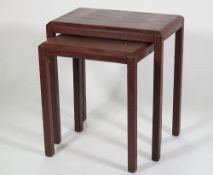 A modern nest of two tables, with faux brown lizard skin upholstery, 55cm wide x 60cm high.