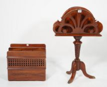 A Victorian style mahogany three division magazine rack on three outswept supports,