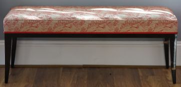A lacquered rectangular stool on swept legs, 120cm wide x 50cm high.