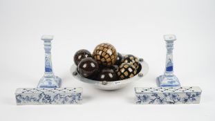 A modern pewter bowl, 42cm diameter, containing a selection of lacquered composite carpet bowls,