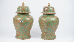A pair of modern pottery urns and covers,