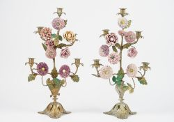A pair of modern gilt metal five branch candelabra decorated with porcelain headed flowers issuing