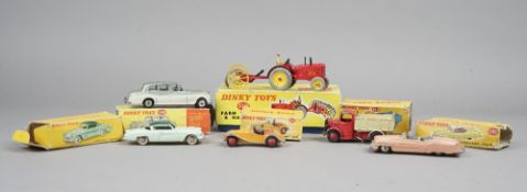 Six Dinky die-cast vehicles, comprising; 310 farm tractor and hay rake, 102 M.G.