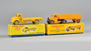 A Dinky 419 Leyland Comet wagon and a Dinky 409 Bedford articulated lorry, both boxed, (2).