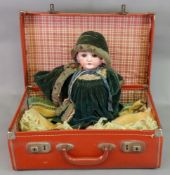 A German painted bisque headed doll, cir
