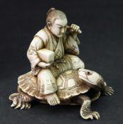 A Japanese ivory okimono of a man, Meiji