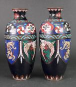 A pair of cloisonne vases, circa 1900, of slender ovoid form,