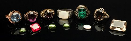 A collection of gem-set rings comprising
