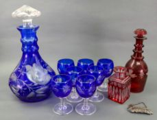 A glass decanter and stopper and seven g