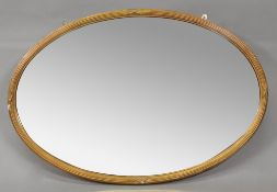 A George III style oval bevel edge wall mirror, circa 1900,
