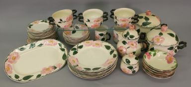 A Villeroy & Boch Wild-Rose 40-piece tea and dinner service and five similar pudding bowls (45).