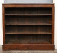 A late Victorian mahogany stained pine dwarf open fronted bookcase,