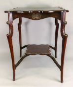 An Edwardian carved mahogany two tier window table, on cabriole legs,