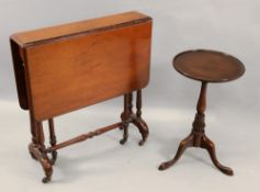 A Victorian walnut Sutherland table, on dual turned end standards,