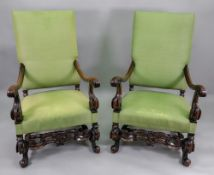 A pair of William & Mary walnut frame elbow chairs,