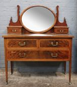 An Edwardian mahogany satinwood crossbanded boxwood and ebony strung dressing table,