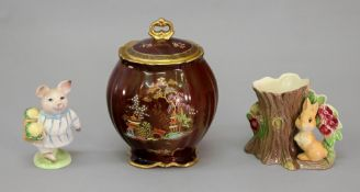 A Crown Devon rouge royale chinoiserie pattern jar and cover, 16cm high,