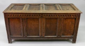 A large late 17th century oak coffer, of panelled construction, with gouged frieze,