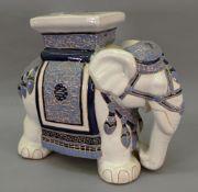 A large modern ceramic elephant stool, 52cm wide x 44cm high, a group of three elephants,