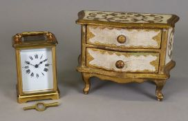 A French brass carriage timepiece, with key, and a miniature Florentine two drawer commode (3).