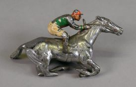 A chromium plated horse with jockey up car mascot, 13cm wide.