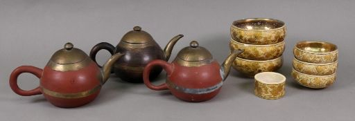 A set of three Kashmiri gilt metal and painted papier mache finger bowls,