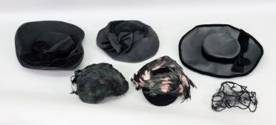 Erik de Paris; a lady's black velvet and feather hat, with elasticated strap,