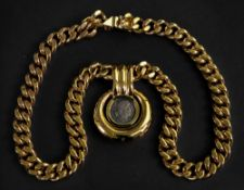 A gold plated pendant necklace, the heavy curb-link necklace suspending a circular pendant,