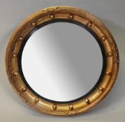 A small Regency style circular convex wall mirror, 19th century,