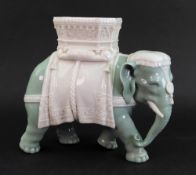 A James Hadley Royal Worcester vase, in the form of an elephant with howdah, 23cm wide x 20cm high.