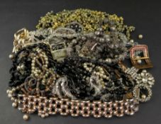 A collection of 19th century and later jewellery including a pair of oval paste set buckles;