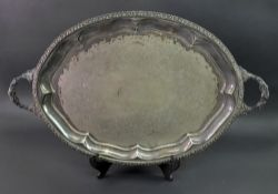 A George IV style oval two handled electroplate tray, with fruiting vine cast border and handles,
