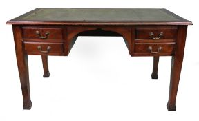 An early 20th century mahogany desk with four short drawers and leather inset top,