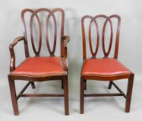 A set of six reproduction George III style mahogany dining chairs,