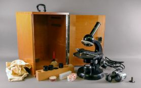 A Carl Zeiss microscope, second half 20th century, in fitted wooden carrying case.
