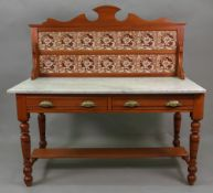 A late Victorian walnut washstand with floral printed tiled inset back, white marble top,